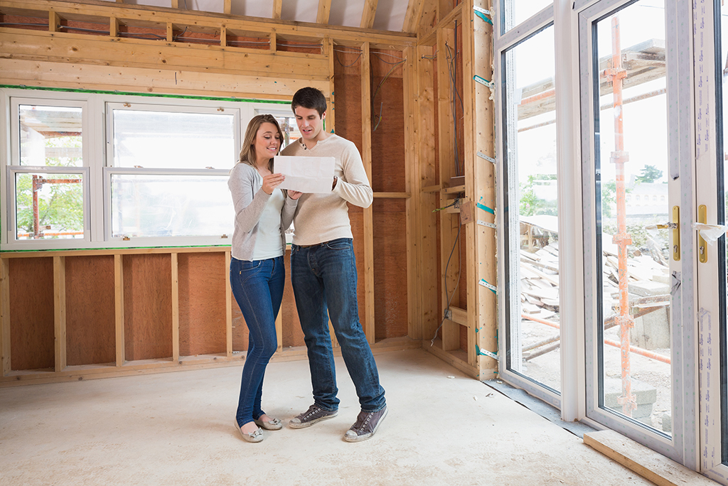 Couple looking at plan