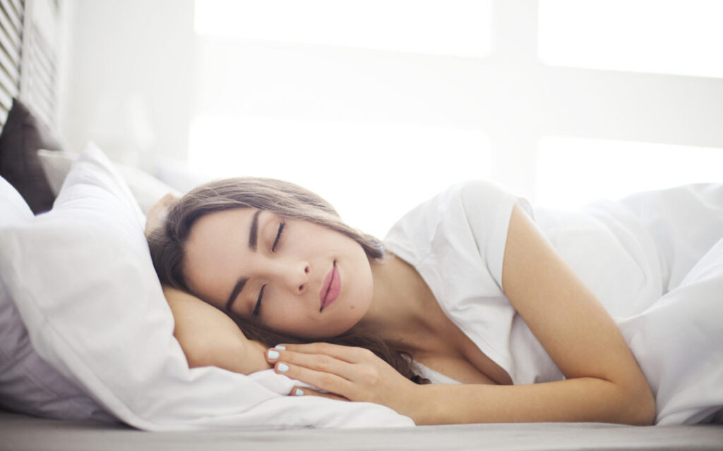 beautiful woman sleaping in white bed