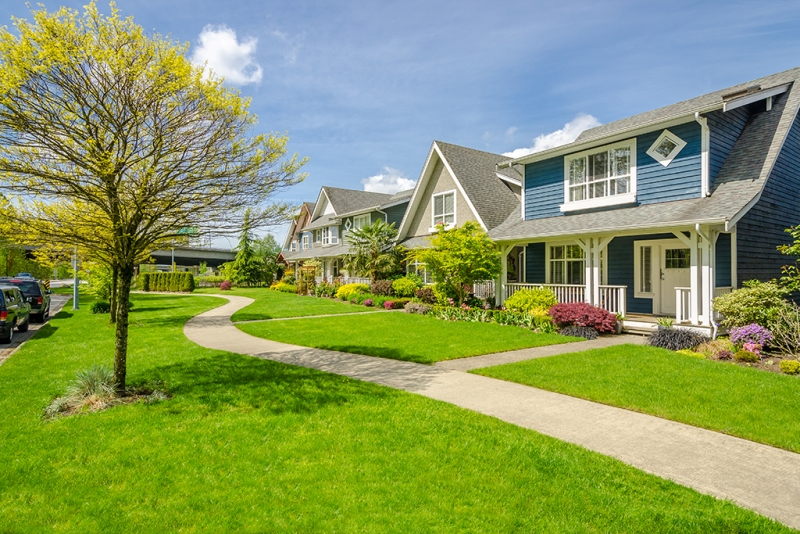A perfect neighbourhood. Houses in suburb at Spring in the north America.